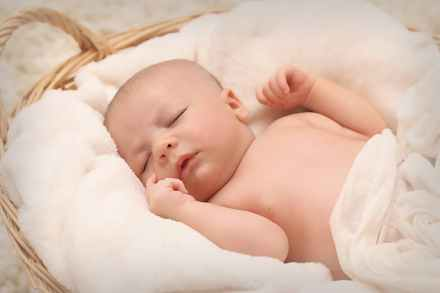 baby sleeping on white cotton